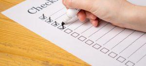 A man filling in a checklist.