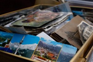 Numerous postcards packed in a box.