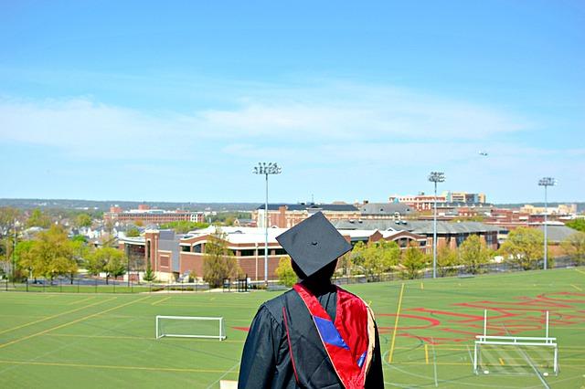 A college graduate at a stadium.